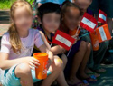 The cups were given to children by The Home Depot gay parade marchers, while homosexual activists followed up by introducing them to gay sex websites.