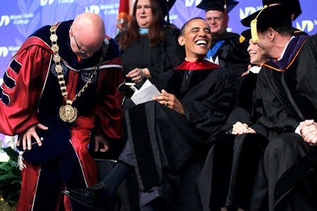 President Barack Obama at the Miami Dade College North and West Campus graduation on April 29, 2011. (AP Photo/Charles Dharapak.)