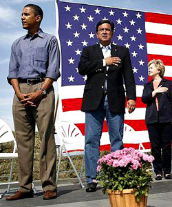 Obama, when asked about this picture said that flag pins and putting your hand over your heart had no meaning for love of country.  Really?  Then why during his campaign for president suddenly he had flags surround him on the stage, in his logo, and on his coat at every debate?  Liar, liar, pants on fire!