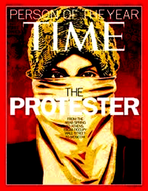 "Activist Shepard Fairey, of Obama's 'HOPE' poster fame, designed the cover image for Time's ""Person Of The Year."""