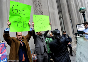 Derrick Tabacco, left, a small business owner, joins a small group counter-demonstrating against the Occupy Wall Street march near the New York Stock Exchange on Thursday.